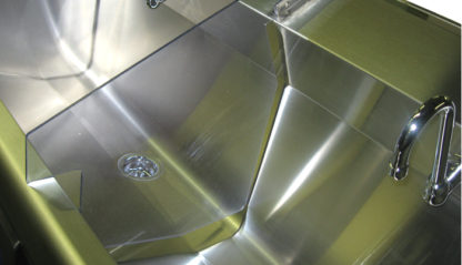 SurgiKleen® Stainless Steel Floor Mount Two Bay Scrub Sink showing sink interior and splashguard detail