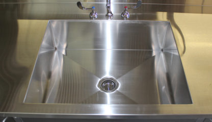 SterilKleen® Stainless Steel Multi-Storage Casework with Sink showing interior of sink detail