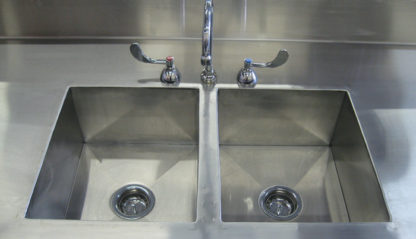 SterilKleen® Stainless Steel Pharmaceutical Casework with Two Sinks showing dual sink detail and goose neck faucet with wing handles
