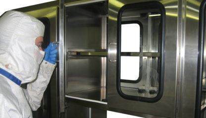 SterilKleen® Stainless Steel Sloped Top Cabinet showing user opening top cabinet with doors that have safety glass