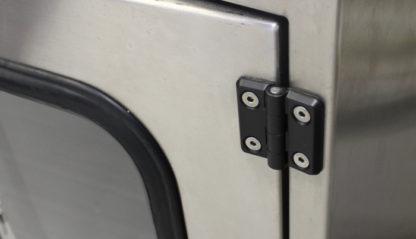 SterilKleen® Stainless Steel Hospital Wall Custom Casework Cabinet showing optional hinge in black