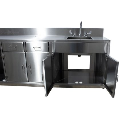 SterilKleen® Stainless Steel Lab Cabinet with Sink shown with undersink cabinet open with view of interior and rear cutout for plumbing attachment.